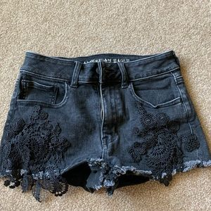 AE black jean shorts with lace detailing
